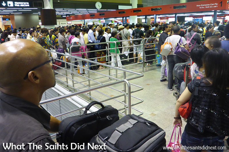 Queuing at a very crowded Don Muang airport in Bangkok, Thailand. The lesson here is don't be late, leave plenty of time for airport delays such as long queues!
