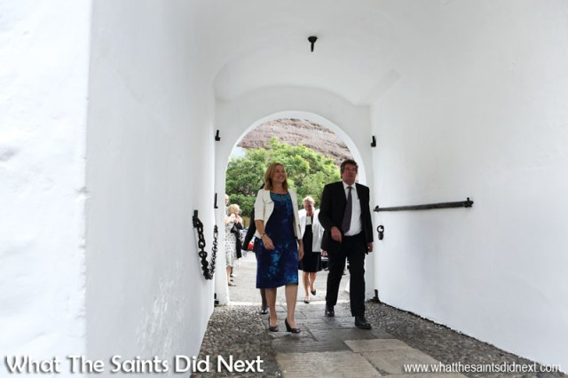 Governor Lisa Phillips making her way into The Castle for the first time, accompanied by Head of the Governor's Office, Sean Burns. Inauguration Ceremony of Her Excellency the Governor, Ms Lisa Phillips - Supreme Court Terrace, Jamestown, St Helena.