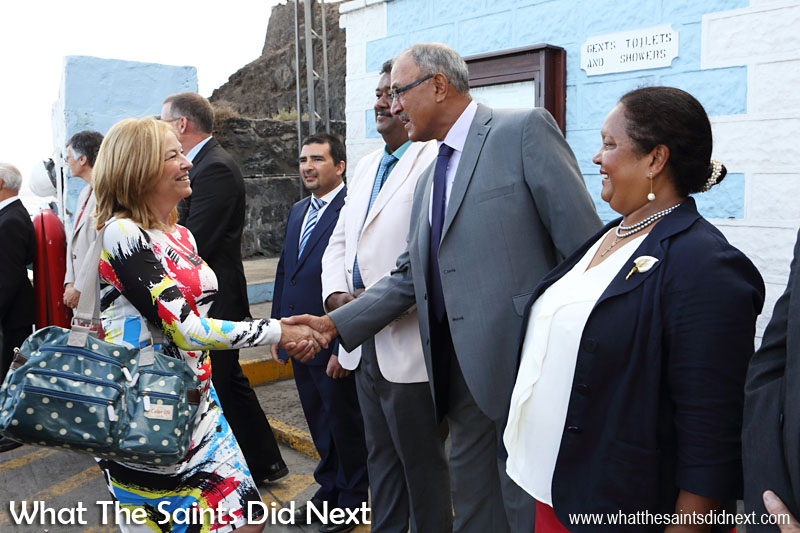 Her Excellency the Governor Designate, Ms Lisa Phillips, coming ashore in Jamestown and being met on the wharf by the island's elected members and other government officials. Seen here greeting Councillor Lawson Henry.