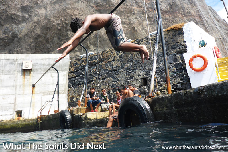 St Helena Culture - Swimming in the sea, off the wharf landing steps is a favourite summer pastime for many of the Saints living in Jamestown, especially the children.