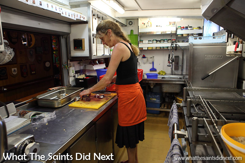 Fish for dinner tonight - Marianne preparing dinner in the galley on board Bark Europa.
