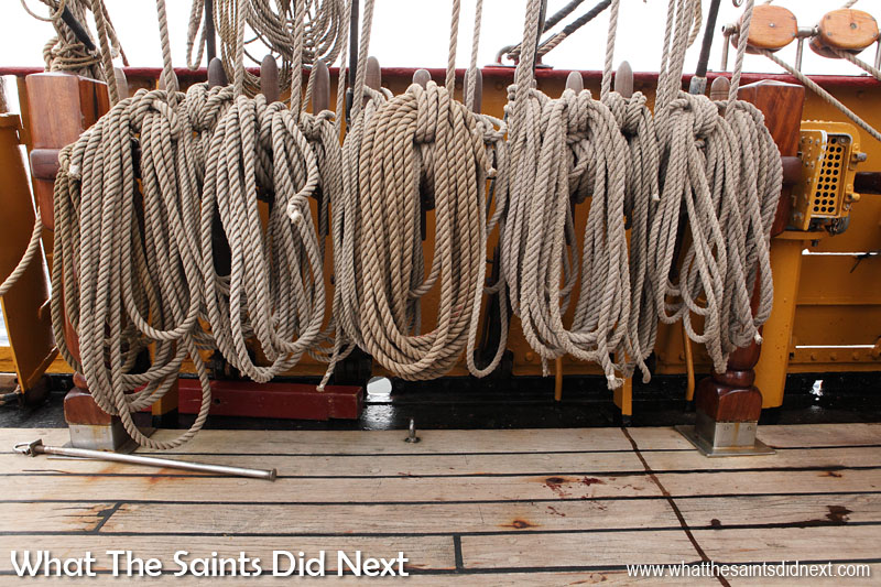 Bark Europa ship rigging lines on are coiled everywhere on deck. Teamwork is required to handle these lines which set, hand and trim the 30 different sails.