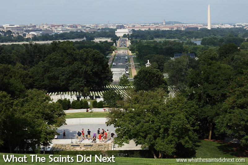 Arlington National Cemetery, is sprawled across high ground, giving great views of central Washington DC just over the Potomac River. This picture shows President John F Kennedy's grave in the foreground, Memorial Avenue outside the cemetery leading to the Lincoln Memorial in the distance. The spire of the Washington Monument is clearly visible off to the right.
