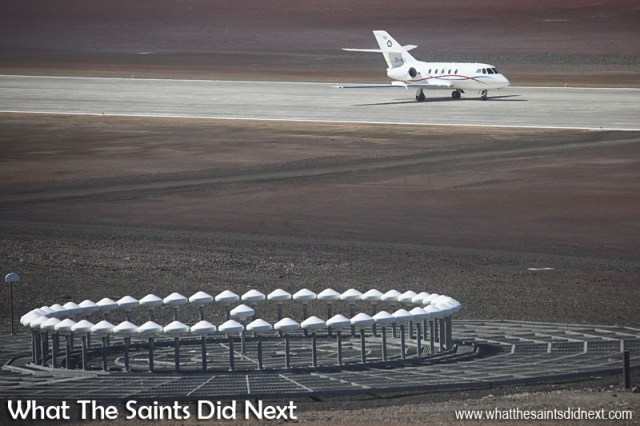 The Guardian Air, Dassault Falcon 20, air ambulance taxiing back along the runway after a successful landing. The St Helena Airport, DVOR radar is visible in the foreground.