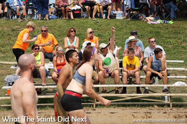 The spectators are a mix of team supporters and others just taking in this fascinating spectacle. July Fourth celebrations - Mississippi Mud Volleyball Tournament takes place every year in Hannibal, Missouri.