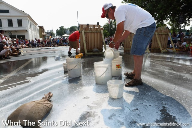 Fence painting in Hannibal, Missouri, for 'Tom Sawyer Day' is a popular event every July Fourth. The whitewash on the fences are hosed off between each 'race' and used again for the next set of entrants. Local businesses all sponsor the events each year.