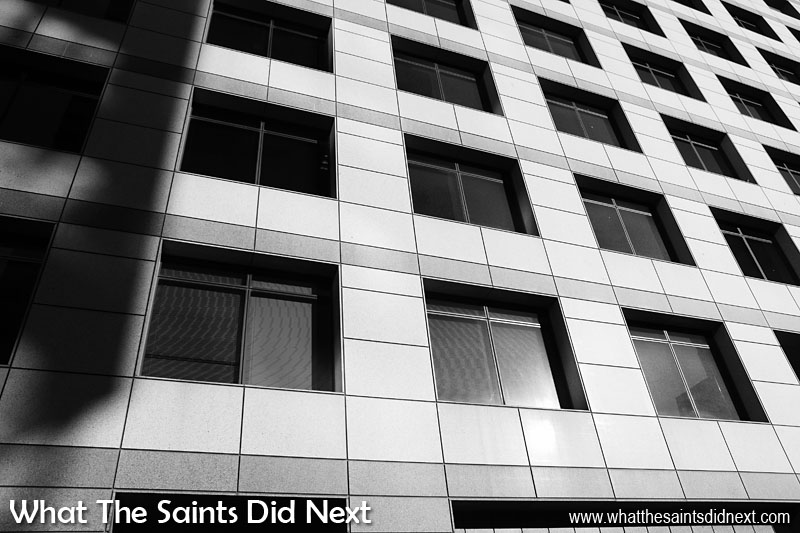 Look out for textures and patterns when shooting black and white photography. Man made structures are often a good source of repetitive patterns, especially cityscapes, such as this office building in Cape Town, South Africa. This was taken from the open top of the double-decker red bus, city sightseeing tour as we drove between the buildings.