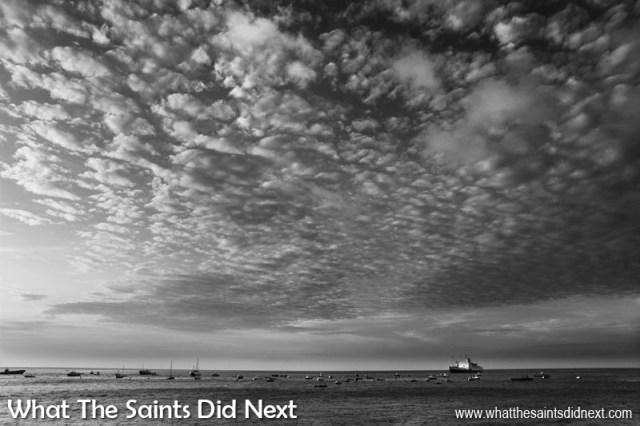 Black and White Photography Tips - Textures and patters translate perfectly showing how to take great black and white photographs with this cloudscape over the RMS St Helena, anchored in James Bay. Composition is rather extreme allowing the sky to dominate the frame.