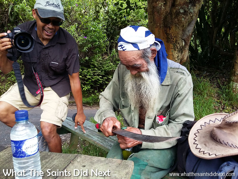 Candid Moments - I loved this moment in Sandy Bay with Raymond opening a beer bottle using a machete! It was all over in a second but having the phone in camera mode meant I could capture it! Tips To Improve Your Mobile Photography.