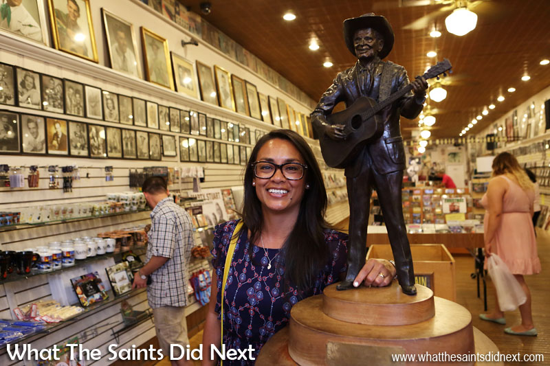 Star-struck next to a brass statue of the 'inventor' of Country & Western music, inside the Ernest Tubb Record Shop, Nashville, Tennessee.