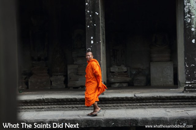 The monks in Southeast Asia wear these striking orange robes. In the Angkor Wat temple the open courtyards made for a natural, well lit, photography space. In this situation when you can visualise how the colours will contrast it's a case of pick your spot then wait. Colour photography tips.