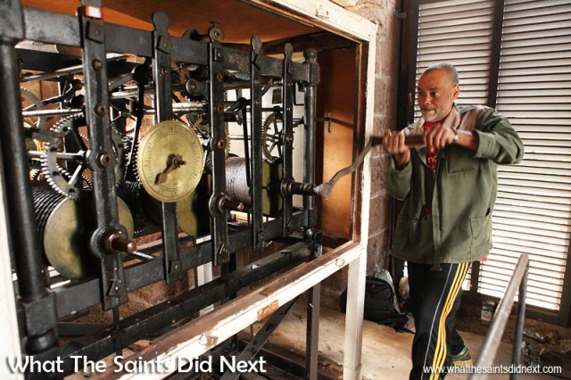 Roddy Yon winding the St James clock which was made in 1786 by Aynsworth Twaites of Clerkenwell. It was placed in St James in 1787 having been provided by the East India Company. Roddy climbs the tower twice a week to keep the clock working. St James St Helena.