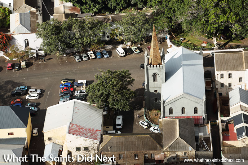 St James Church in Jamestown with its new spire, viewed from the top of Ladder Hill. Castle Gardens can be seen top right; court house and police station top middle (through the trees) and just visible top left is The Castle.  St James Church clock tower, Jamestown, St Helena.