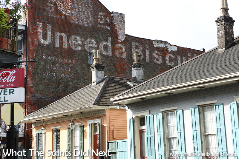 Nabisco biscuits advertising on buildings reaches an audience in New Orleans for the National biscuit company promoting 5c Uneeda biscuits. A favourite of our vintage hand painted signs.