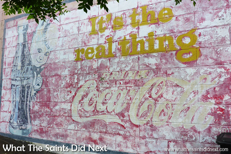 Antique Coca Cola signs featuring Sprite Boy in Vicksburg MS- It's the real thing.