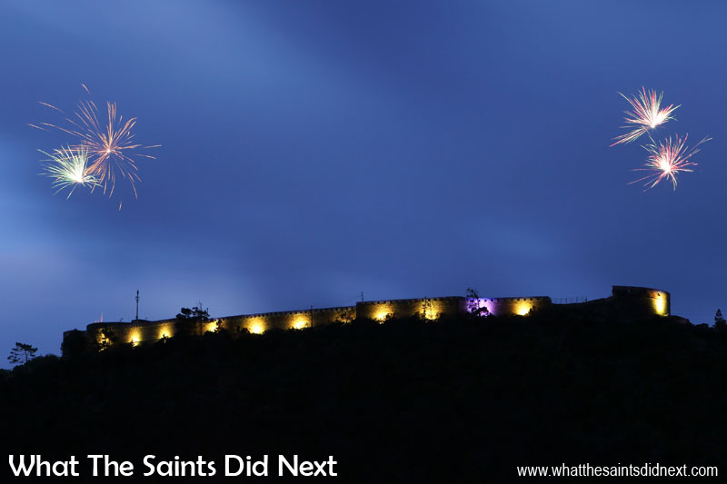 Opening night firework display. Fireworks are launched from both ends of the fort, the loud 'bangs' echoing up and down the valleys. High Knoll Fort lights, St Helena.