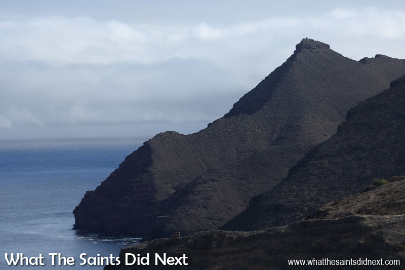 The brooding landmark of Sugar Loaf, viewed from Ladder Hill. The outline of the Banks Battery fortifications can just be seen on the cliffs below to the left. Sugar Loaf Post Box walk, St Helena.