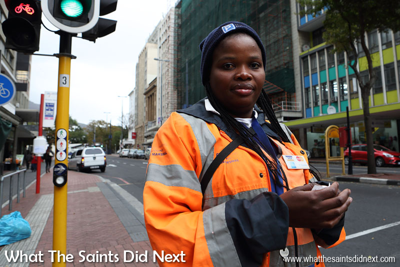 Cape Town People: Parking official, Tabisile, keeping track of the vehicles in Long Street.
