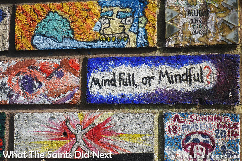 Stokes Croft, Bristol. Mind Full or Mindful? Hmm… Each brick displays individual expression.