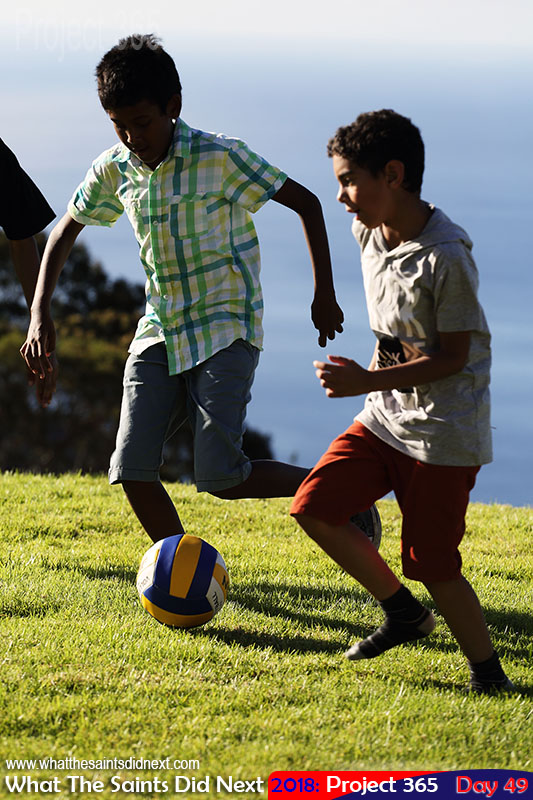 Boys playing football with a volleyball. February, 2018.