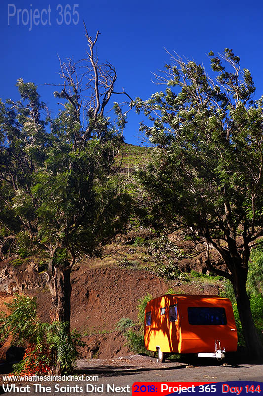 Orange food van brings strong afternoon colours on a clear day.