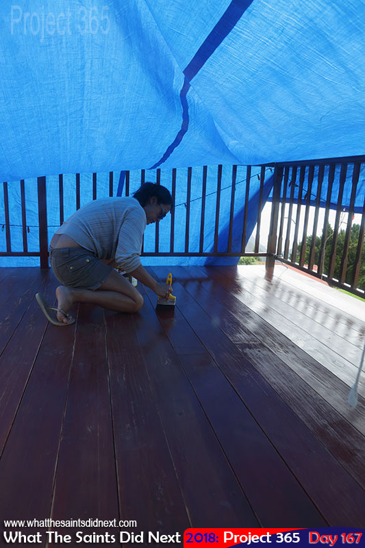 Painting balcony under cover to avoid the rain.