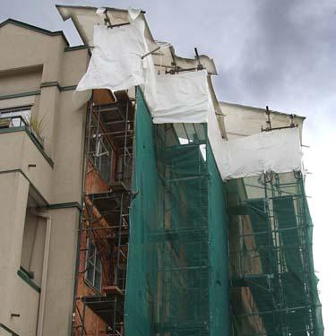 A leaky condo undergoing repairs