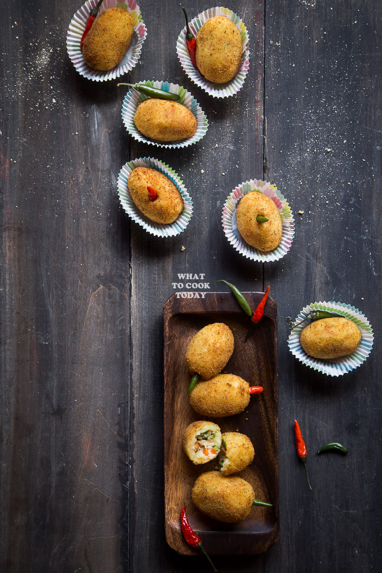 Kroket Kentang / Indonesian Potato Croquette. Seasoned mashed potatoes are filled with aromatic chicken fillings, breaded, fried and served with whole chili