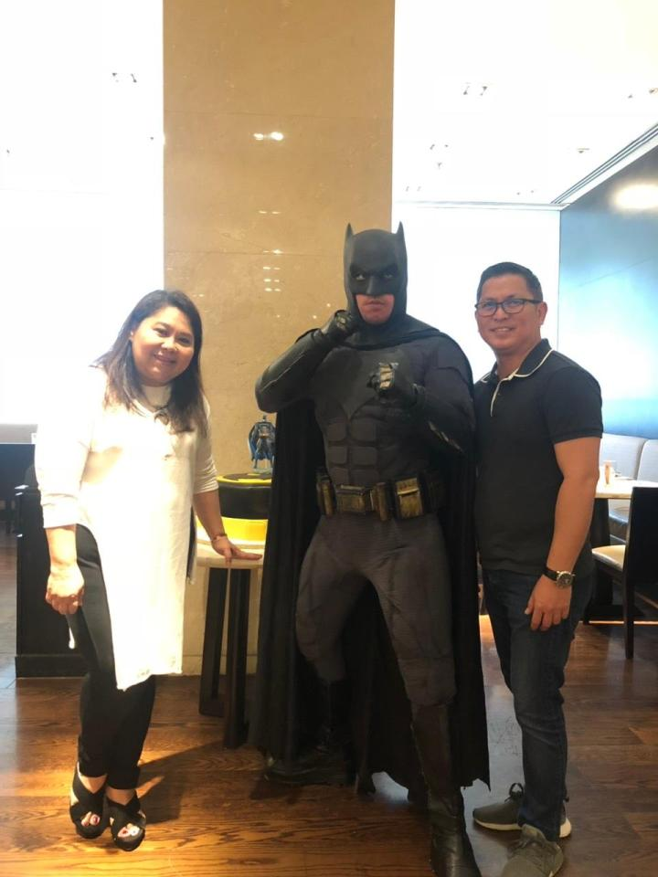 Batman poses for tha camera with guests dining at the Marriott Cafe