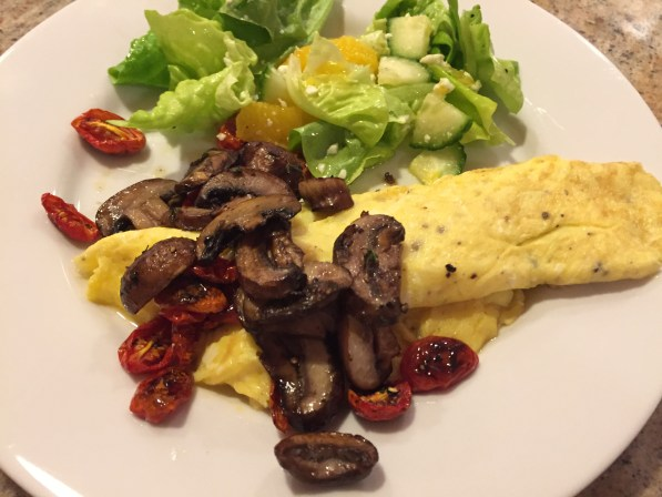 omelet with roasted mushrooms and tomatoes