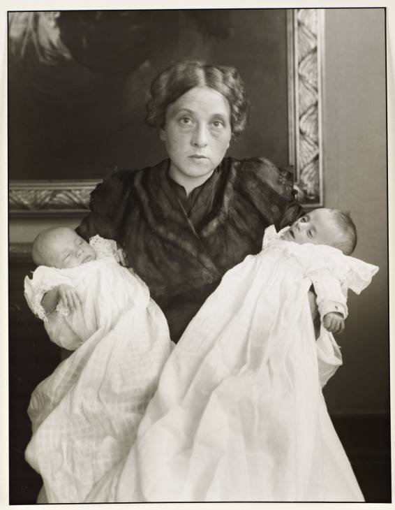 """""""My Wife in Joy and Sorrow"""" (1911/1990), holding their twins, one of whom was stillborn.  by August Sander (courtesy of Gallery Kayafas, Boston)"""
