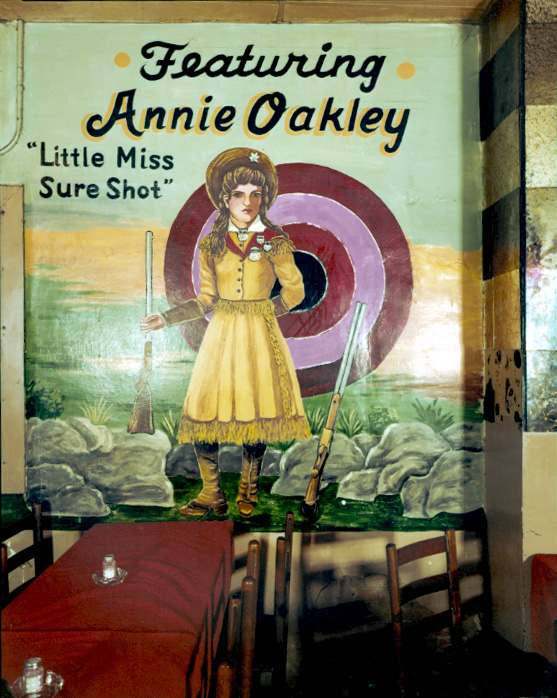 """""""Annie Oakley Painting, Longhorn Ballroom, Dallas, 1979"""" by Jim Dow (courtesy of the artist and Robert Klein Gallery, Boston)"""