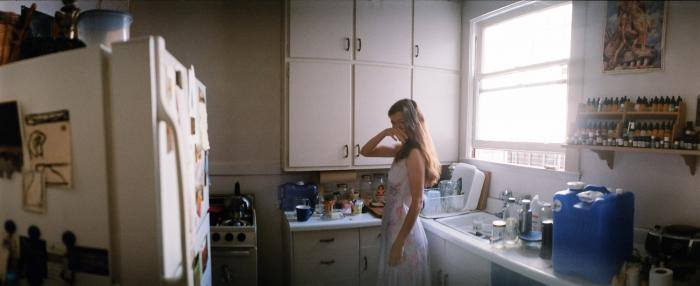 """Sheila in the Kitchen, San Francisco, 2010"" by Joe Vigil; Horizon Perfekt Panoramic, Fujicolor PRO 400H, shown in the Washington Street Gallery, Somerville (courtesy of the artist)."