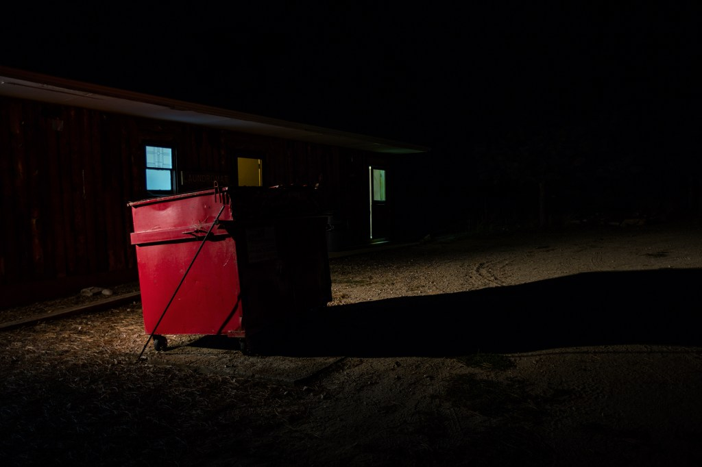 """""""Red Dumpster"""" from the series JCC Ranch by Remi Thornton (courtesy of the artist and Miller Yezerski Gallery, Boston)."""
