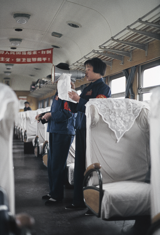 """Untitled (on the train, the staff give a performance, reading quotations of the Little Red Book and singing revolutionary songs), China, 1967"" by Solange Brand (courtesy of the artist and Robert Klein Gallery, Boston)."