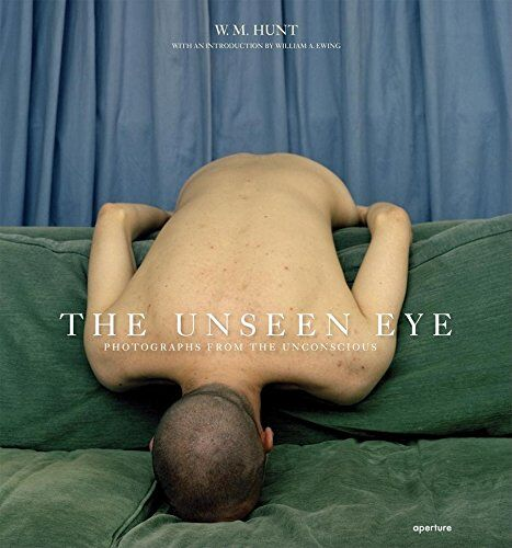 "Book cover for ""The Unseen Eye: Photographs from the Unconscious"" by W.M. Hunt (Aperture, 2011). Photograph ""Untitled, 2004"" digital C print from the series ""Domestic Stages"" by Carrie Levy (American b. 1979), (courtesy of the artist)."