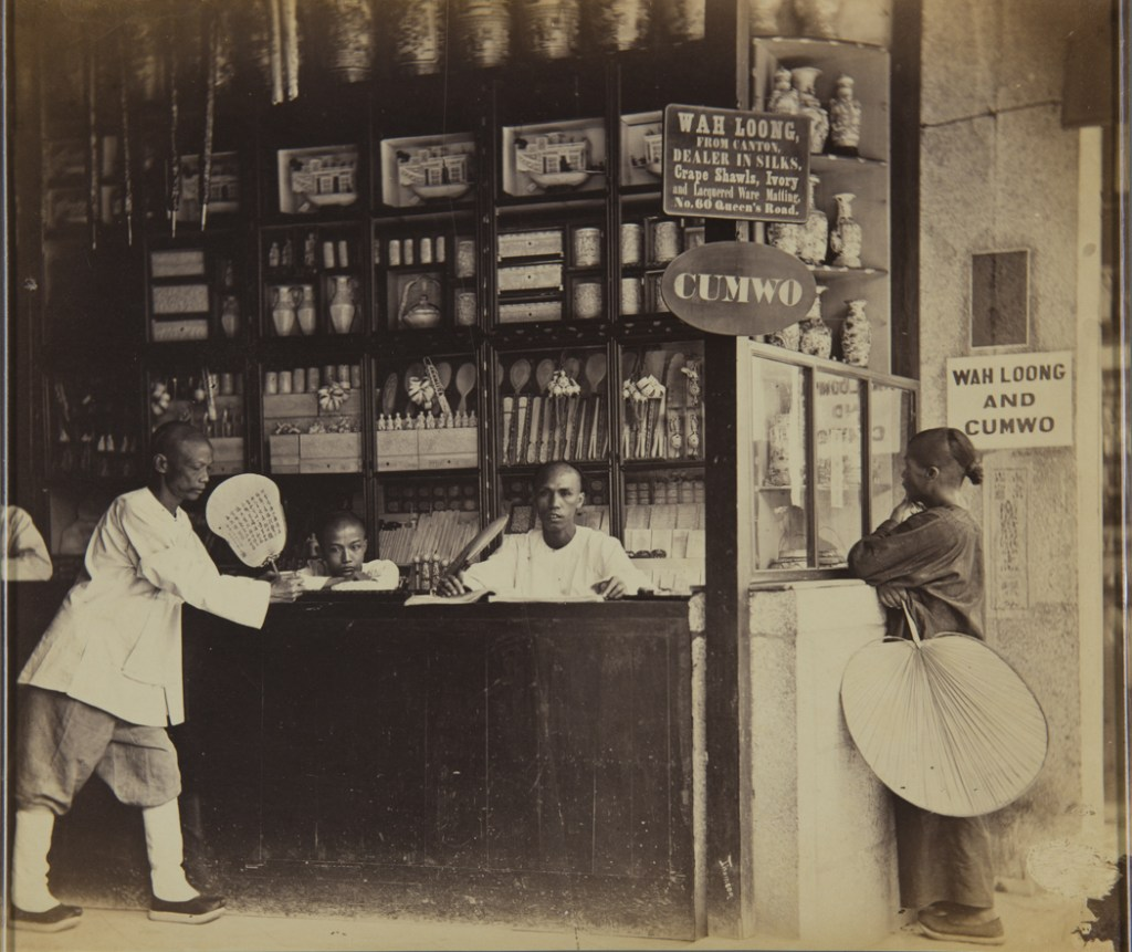 """Inside of Wah Loong and Cumwo Shop at 60 Queen's Road, Hong Kong, 1868"" albumen print by John Thomson (United Kingdom, 1827-1921), (courtesy of the Peabody Essex Museum, Salem, MA)."