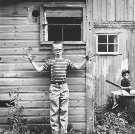 Untitled (Boy Making Gesture) negative from 1959 © Ralph Eugene Meatyard (courtesy of the artist's estate).