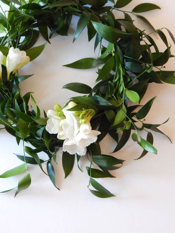 Green wreath with white flowers