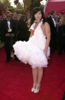"LOS ANGELES, UNITED STATES: Actress and singer Bjork arrives the 73rd Annual Academy Awards at the Shrine Auditorium in Los Angeles 25 March, 2001. Bjork performs and wrote the music for ""I've Seen It All"" nominated for Best Song. AFP PHOTO/Lucy NICHOLSON (Photo credit should read LUCY NICHOLSON/AFP/Getty Images)"
