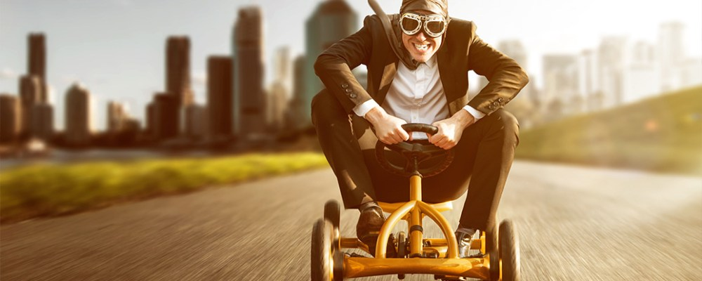 Person on skelter in business suit racing to find a job