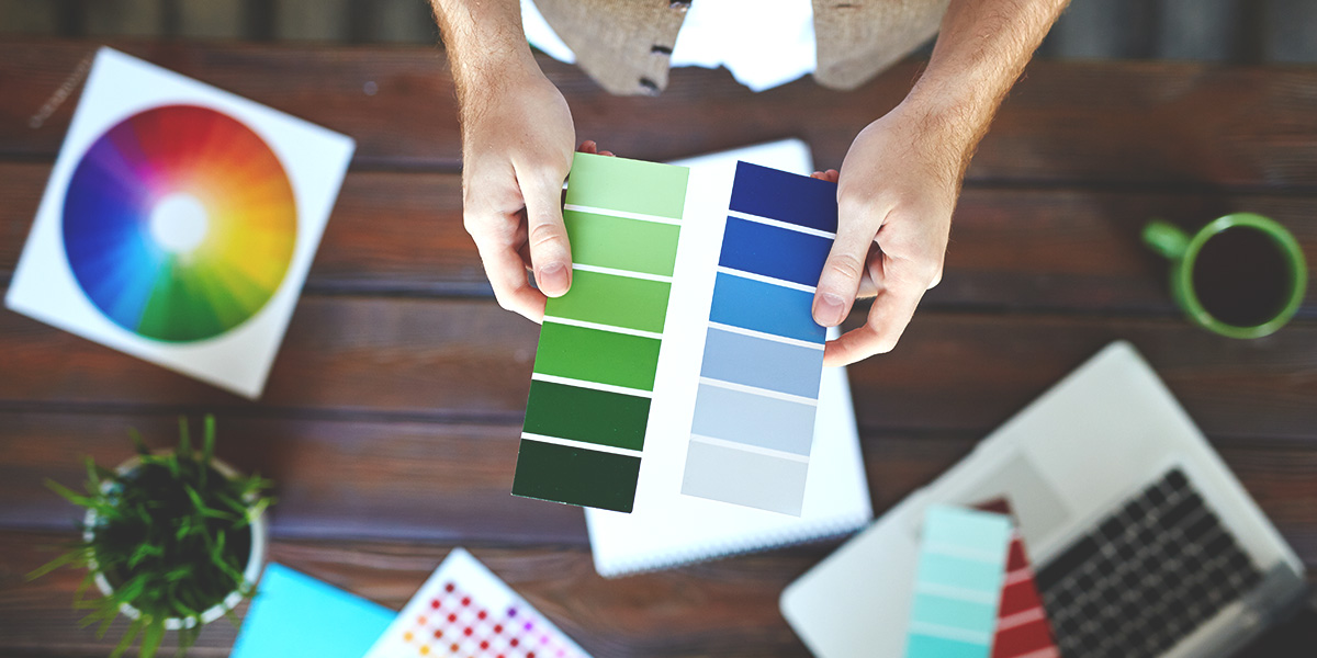 Image of deciding on color, picking the right color for your logo with the help of a palette and flyer.