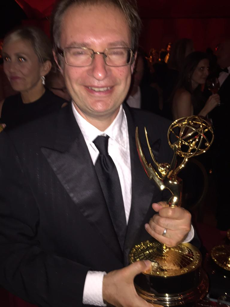 Kevin Cecil proudly displays his Emmy at the post awards show celebration.