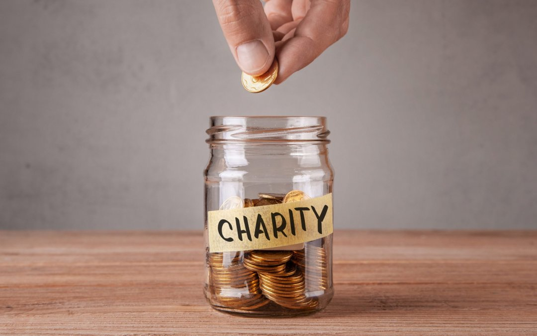 How does the SECURE Act affect qualified charitable distributions?