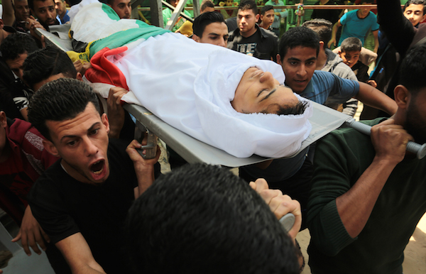 Mourners carry the body of 15-year old Palestinian Jamal Afana, during his funeral in Rafah, southern Gaza Strip, on May 13, 2018. Jamal who was shot in the head by Israeli forces near Rafah in southern Gaza on May 11, succumbed to his wounds the next day. (Abed Rahim Khatib/ Flash90)