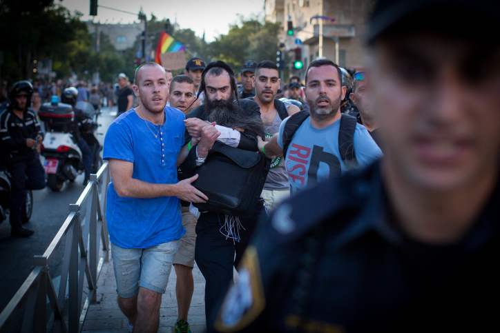 Police arrest Yishai Schlissel, who stabbed six people at the 2015 Jerusalem Pride Parade, killing 16-year-old Shira Banki, July 30, 2015. (Flash90)