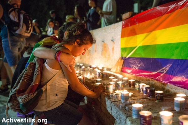 Israeli youth mourn Shira Banki, who was murdered by an ultra-Orthodox man at the Jerusalem Pride Parade, August 2, 2015. The attacker, Yishai Schlissel, stabled six people. (Yotam Ronen/Activestills.org)