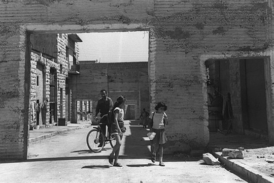 Mizrahim walk around the Mamila neighborhood in West Jerusalem, 1957. Mamila, like countless other neighborhoods and communities, was empied of its Palestinian residents in the 1948 war. (GPO)
