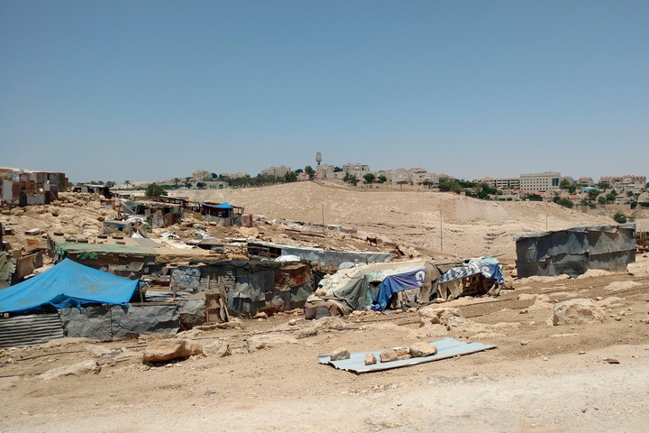 The Bedouin village of Abu Nuwar, in the E1 area of the West Bank. In the background are the southern neighborhoods of Kedar and Ma'ale Adumim, two Israeli settlements near Jerusalem,.