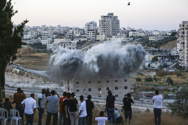 A Palestinian building is blown up by Israeli forces in the village of Sur Baher, East Jerusalem on July 22, 2019. (Wisam Hashlamoun/Flash90)